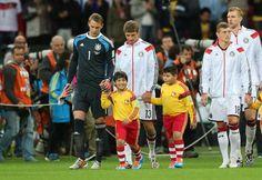 German Goalkeeper Manuel Neuer and brazilian kid named Getúlio Felipe Silva