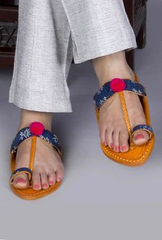 Dabu Print Kolhapuri Chappal Dabu printed hand-crafted Kolhapuri chappals adorned with dabu prints,jute and wooden beads to giive for a subtle and classy look at the same time Color: Brown & multi-color Material: Genuine leather  Finish: Hand-Made Inspiration: Indian kitsch