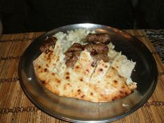 Bosnian Ćevapi with onions in a somun