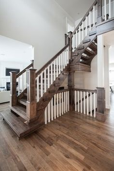 This staircase picture has been taken in a model home by @Wrightland. The rustic flooring is our Charisma FSC-Certified Hard Maple hardwood flooring from the Organik Series. This wood floor includes the Pure Genius, our air-purifying smart floor. #airpurifying #PureGenius #smartfloor #airpur #interiordesign #homedecor #hardwoodflooring #ArtFromNature