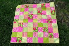 Pink and green baby quilt.