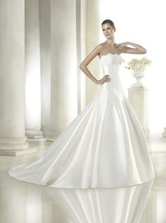 Sayuri - A beautiful A line, strapless satin ball gown. So pretty, with soft lace detail on the bust line.