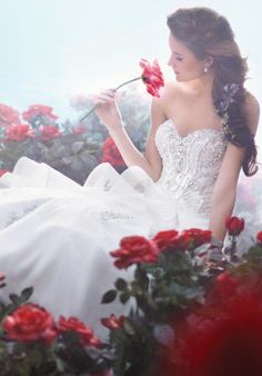 Lace strapless ball gown with sweetheart neckline | Disney Fairy Tale Weddings by Alfred Angelo | https://www.theknot.com/fashion/217217c-disney-fairy-tale-weddings-by-alfred-angelo-wedding-dress