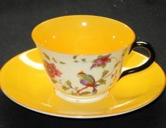 CROWN STAFFORDSHIRE DEEP YELLOW BIRD DELICATE TEA CUP AND SAUCER