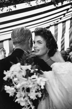 Former US Amb. to Great Britain Joseph Kennedy, dancing with son John F. Kennedy's bride, Jacqueline Bouvier Kennedy, at their wedding reception held at her mother's home.