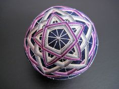 "A variation on the "" echo star "" pattern, using a slightly different arrangement and number of rows for the smallest star, and different co..."