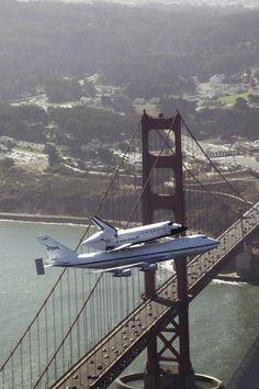 The Endeavour flying over the Golden Gate Bridge