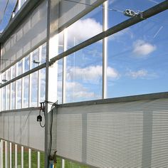 Vertical Screens | Bridge Greenhouses Motorised roll tube screens provide shade to end and sidewalls, as well as making a convenient form of partitioning to create compartments.   Roll screens are also used for very wide span roof structures, allowing maximum air circulation as well as flexibility in the amount of shade. Roof Structure, Greenhouses, Screens, Flexibility, Blinds, Bridge, Tube, Shades, Windows