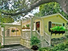 Love this delightful yellow house. And the outdoor patio/pergola - perfect! Golden Storybook Cottage In Carmel By The Sea Little Cottages, Cabins And Cottages, Beach Cottages, Little Houses, Country Cottages, Yellow Cottage, Cute Cottage, Beach Cottage Style, Storybook Homes