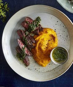 Get the recipe for Hanger Steak With Buttery Mashed Carrots.
