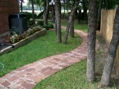 GroundScape, a Fort Worth Landscape Company, installs a beautiful stone pathway along a side yard winding through the trees. Slate Walkway, Gravel Walkway, Outdoor Walkway, Walkway Ideas, Walkways, Flower Bed Edging, Stone Edging, White Gravel, Circular Patio