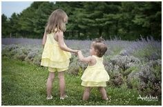Appletini Photography Gorgeous lavender field photo shoot.  These sisters are so cute and the purple backdrop is lovely!