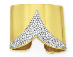 A DIAMOND AND GOLD CUFF BRACELET, BY CARTIER   Designed as a polished 18k gold hinged cuff, set at the top with a circular-cut diamond V-shaped plaque, mounted in platinum and 18k gold, 2¼ ins. diameter  Signed Cartier, no. 10674