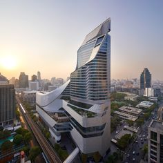 AL_A, the architecture practice of Amanda Levete, has completed a striking retail, leisure and hotel tower in central Bangkok. Located within the former gardens of the British Embassy, along . Cabinet D Architecture, Architecture Awards, Futuristic Architecture, Contemporary Architecture, Amazing Architecture, Architecture Design, Contemporary Museum, Commercial Architecture, Building Architecture