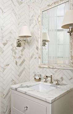 wow. herringbone patterned marble tile walls. yes, please.
