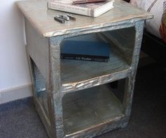 A papier mache end table. I love it -- I'm going to try my hand at papier mache furniture very soon.