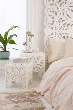 """Sienna Carved Side Table Set, Small table dimensions: 11.75""""l x 11.75""""w x 12""""h - Large table dimensions: 15""""l x 15""""w x 16""""h $179 (Urban Outfitters)"""