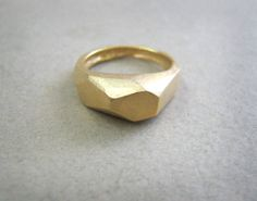 Hey, I found this really awesome Etsy listing at http://www.etsy.com/listing/154869264/faceted-golden-ring-rustic-finish-can-be