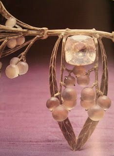 Close-up of a Rene Lalique brooch. The berries are carved from rock crystal