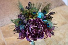wedding flowers teal lime plum   Purple and teal peacock wedding bouquet by emlowi