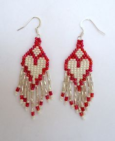 Dangling beaded  earrings with seed beads in the by JoolsbyAveril
