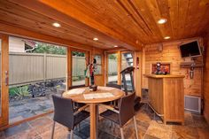 Contemporary Basement with Carpet, Exposed beam, High ceiling, slate tile floors