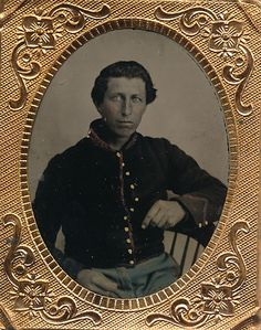 Ninth plate tintype of a Federal artilleryman. Seated in his artillery jacket…