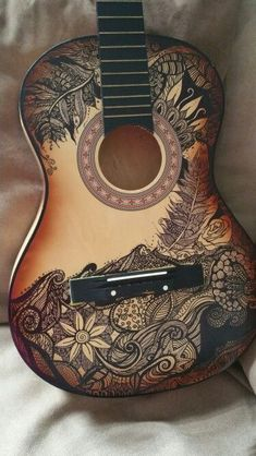 Sharpie art on an old broken guitar i found in the trash. One man's trash is another women's treasure ;) #AcousticGuitar