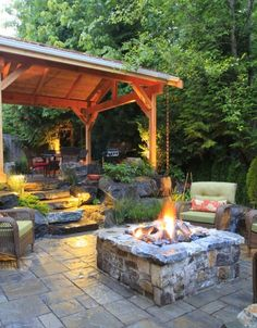 Square fire pit off of covered patio area