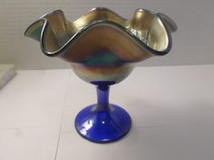Hey, I found this really awesome Etsy listing at https://www.etsy.com/listing/222536891/fenton-carnival-glass-compote-peacock