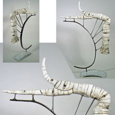 """Jamie E. Hatch. Wrought-iron, granite and clay industrialized aspen sculpture.   30"""" tall x 20"""" wide x 4"""" deep."""
