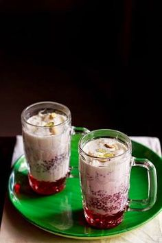 falooda recipe with ice cream - layered summer dessert beverage made with milk, rose syrup, sabja seeds, falooda sev, dry fruits and ice cream. a popular north indian summer drink. step by step recipe. Pakistani Desserts, Indian Desserts, Indian Sweets, Sweet Desserts, Sweet Recipes, Veg Recipes Of India, Indian Veg Recipes, Punjabi Recipes, Vegetarian Recipes