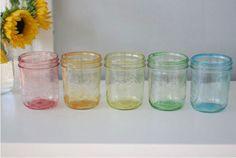50 Best Ways to Use Mason Jars  Tinted Mason Jars Use these colorfully tinted jars as lovely vases. Get the tutorial on Momtasic DIY.