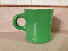 US $12.00 in Pottery & Glass, Pottery & China, China & Dinnerware Vintage HALL Restaurant Ware Heavy Green & White Coffee Mug Excellent condition, and the handle is shaped like an O.