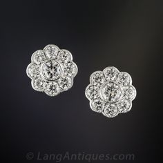 Classic ultra sparkling circular cluster or flower earrings, newly recreated for us in London, in gleaming 18K white gold. Each earring contains 8 European-cut diamond petals surrounding a larger center stone, adding up to 1.50 carats of scintillating flash. Just shy of 1/2 inch diameter.