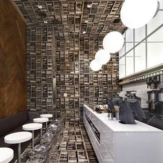 This espresso bar to be located near Grand Central Station in New York was designed by New York studio Nemaworkshop to resemble a library turned on its side.
