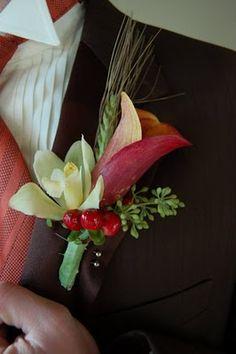 Calla Lilies, Mini Cymbidium Orchid, Wheatgrass, Hypericum Berry, Seeded Eucalyptus