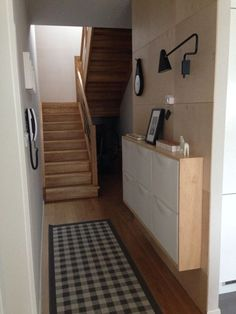 Plywood wall and IKEA TRONES cabinets in my hallway. - I like this staircase, too. by blanca