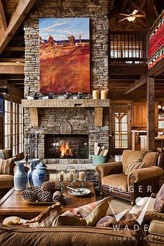roger wade studio interior design photography of rustic living room vignette towards fireplace in luxury cabin, private residence, valle crucis, north carolina, by log homes of america