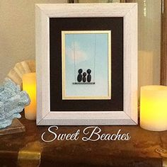 """Pebble Art """" Swing III """" Beach Decor Stone Rock People Baby Shower Gift. Swing III Pebble art of beach stones and driftwood gathered form the Pacific Coast of Washington State. 10 3/4 X 12 3/4 X inches outside dimensions of rustic white wood frame . Ships same or next day VIA USPS Priority Mail 1 to 3 days delivery in the USA."""