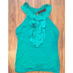 Super cute dressy tank top from The Limited Perfect under a blazer for work. Or wear alone with jeans and heels! Pretty emerald green color and soft fabric. Nice ruffle detail. The Limited Tops Tank Tops