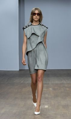 structural shift dress:  shelved/waved detailing to front and triple grommet punch to black leather strip at each shoulder      (by the design label ALTEWAISAOME, MBFW Stockholm, s/s 2013)