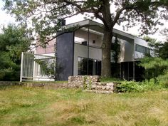 """Gropius- Regional Modernism •His house in Lincoln, Mass. helped introduce this new idea •Blends modern forms with local materials and building traditions as well as making allowances for local climate •House uses wood framing, wood cladding, and stacked stone foundation with a flat roof """"white box"""" and open plan design"""