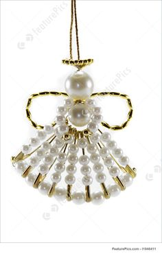 Holidays: Christmas Angel ornament with gold wings against a white background.