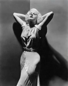 Jean Harlow in a stunning dress, 1930s.  Harlow was the first blonde bombshell