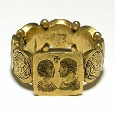 Gold signet-ring composed of a square bezel with angled sides and a hoop constructed of seven small medallions between each of which are two small granules. On the bezel a confronted male and female bust, above them, a cross; Byzantine Jewelry, Medieval Jewelry, Ancient Jewelry, Wiccan Jewelry, Antique Rings, Antique Gold, Antique Jewelry, Vintage Jewelry, Roman Jewelry