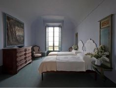 Located in the Piacenza hills outside Milan, Villa Chiesuola is an imposing structure with a private chapel, an enclosed courtyard, and more than 20,000 sq