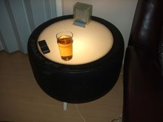 Recycled tyre - into a light up table.  Awesome outdoor furniture!