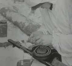 Finnish soldier filling his Suomi submachine gun's drum magazine, March 1943 Drum Magazine, Submachine Gun, Ww2 Photos, Finland, Soldiers, Wwii, Army, Military, History