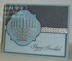 "By Yapha Mason. Hanukkah card. How I would CASE the card: Stamp Menorah in VersaMark on light blue & heat emboss with sparkly silver powder. Die-cut frame; trace outside of die on black for border. Background: Gray panel dry-embossed, overlaid at bottom with designer paper. Faux ribbon punched, VersaMarked, heat embossed with same sparkly silver powder. Punch another in black to place under silver one. Attach all to light blue card base. Uses stamps from Stampin' Up's ""Jewish Celebrations."""